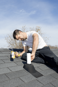 Roof Leak Repair contractor fixing shingle roof